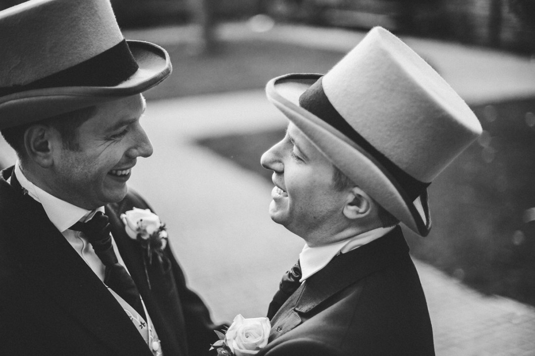 Groom's wearing top hats at Manchester wedding