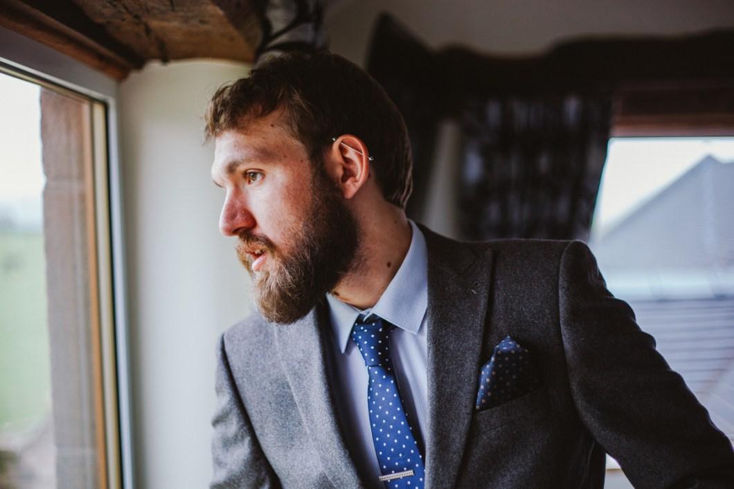 Usher wearing grey tweed suit
