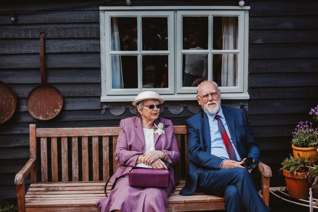 Elderly wedding guests sat in the sun