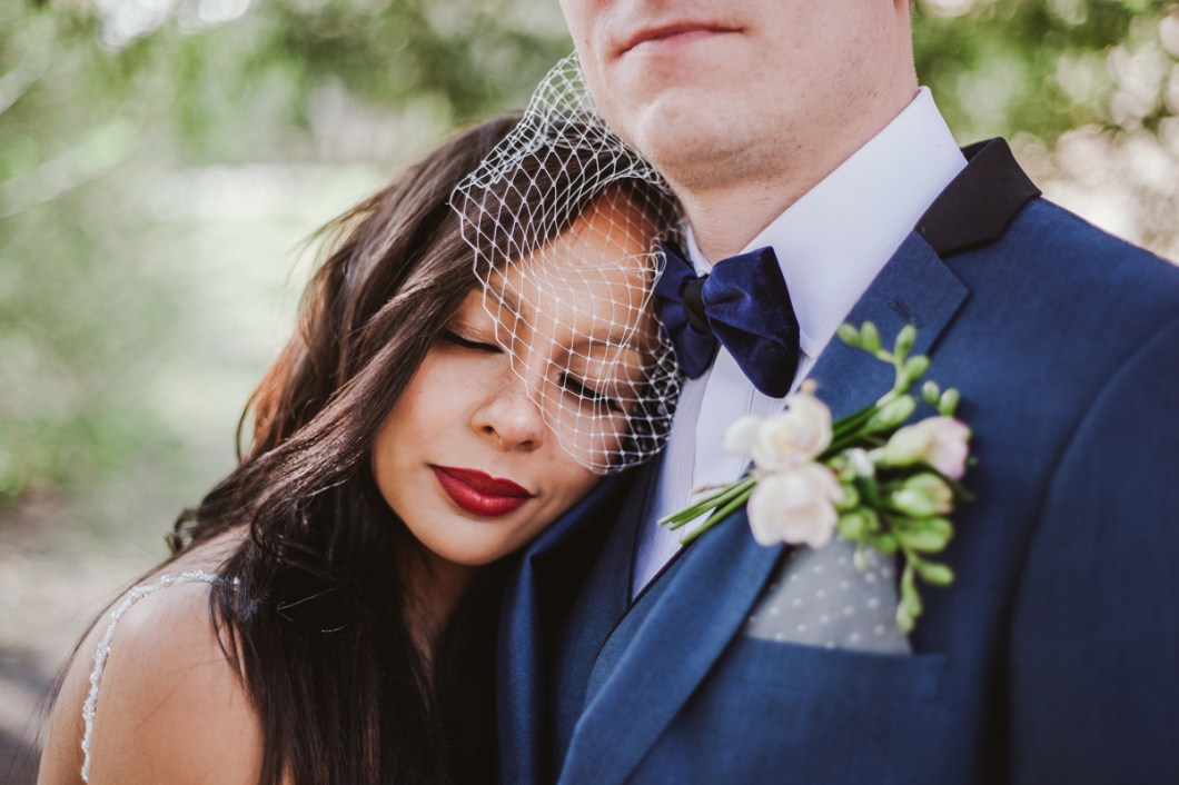 Beautiful portrait of the bride with birdcage veil