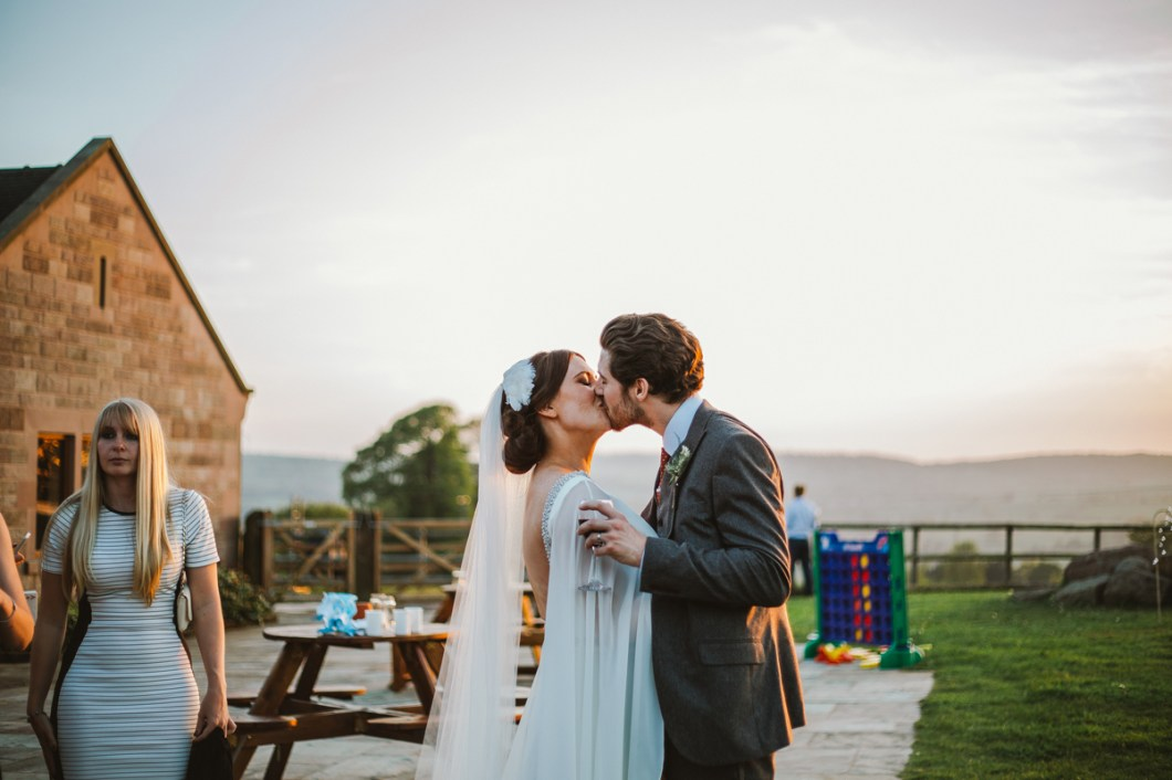 Bride and groom kiss at Heaton House Farm