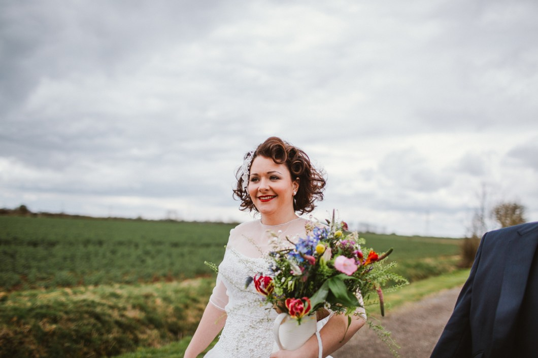Vintage bride with colourful bouquet