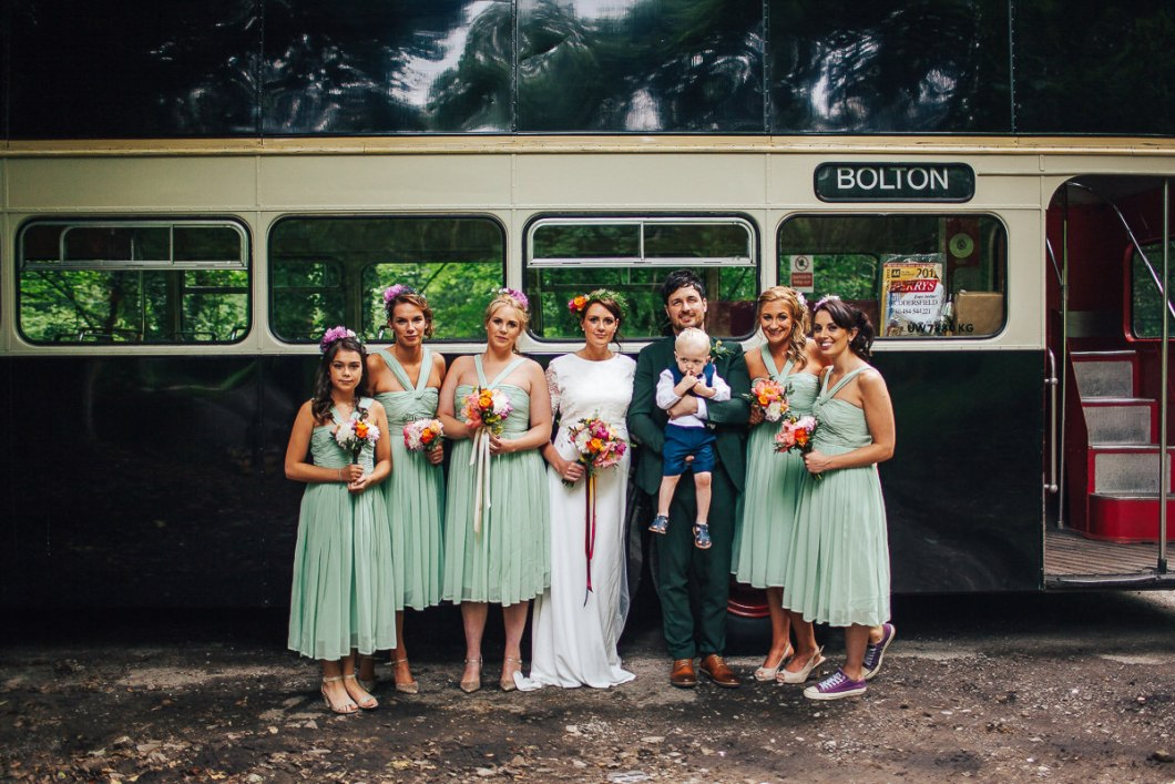 Bridesmaids with a vintage bus