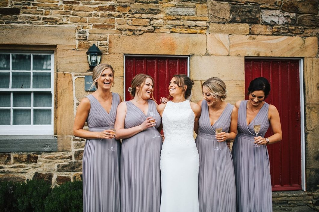 Bridesmaids dusty purple dresses