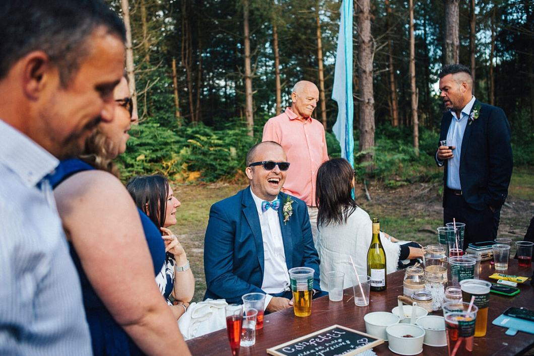 Guests laughing at the woodland wedding