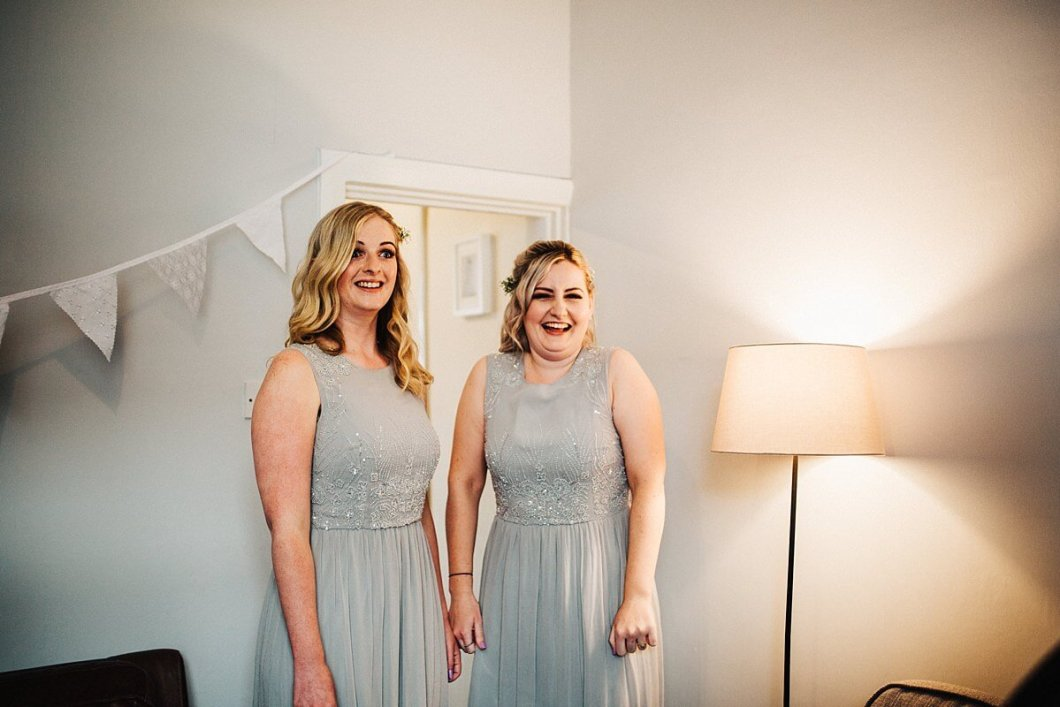 Bridesmaids wearing silver grey dresses