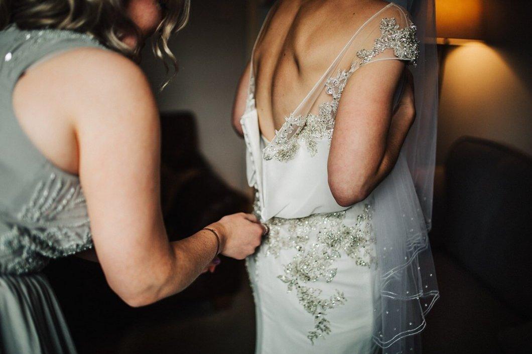 Bride's beaded Enzoani dress