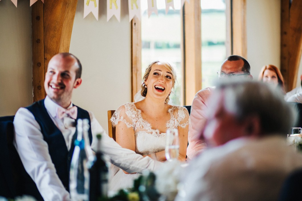 Bride laughing at the speech
