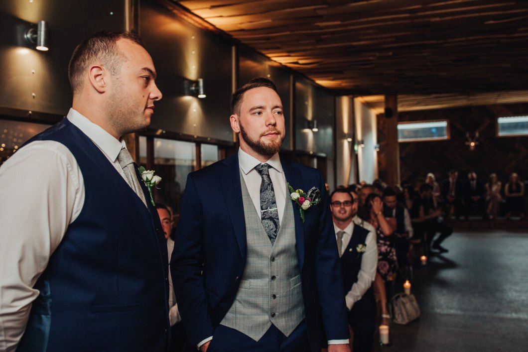 The groom in a blue suit