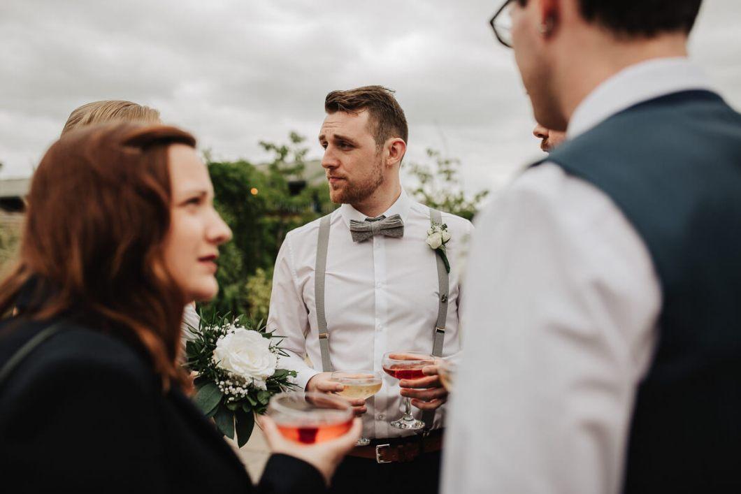 Usher wearing grey bow tie
