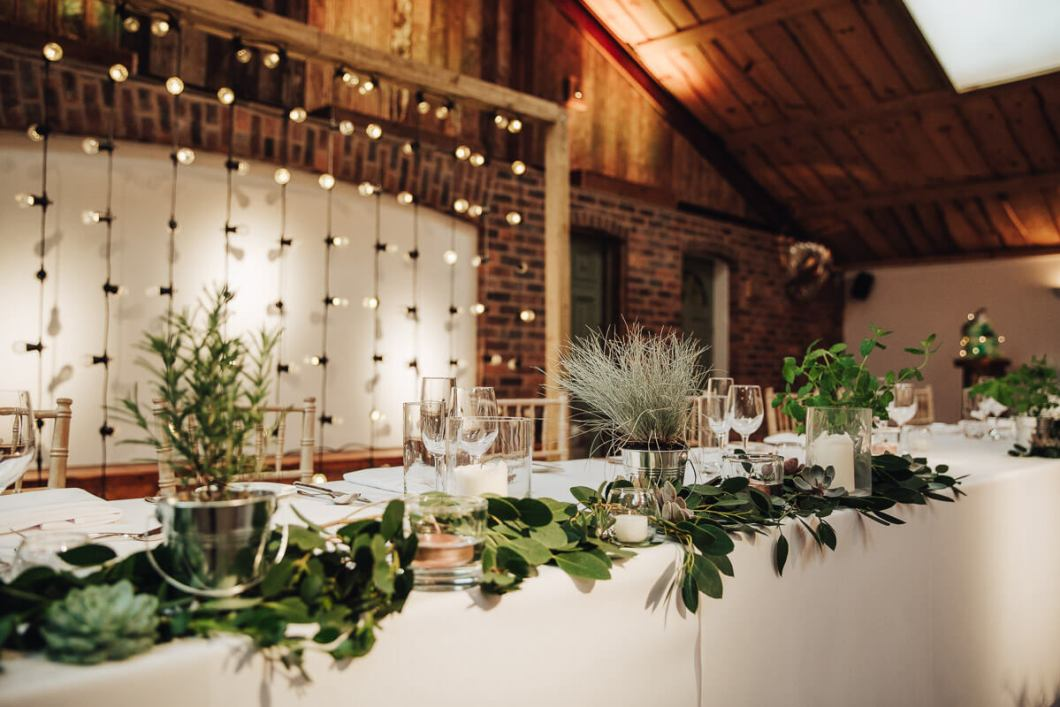 Industrial themed wedding with green foliage