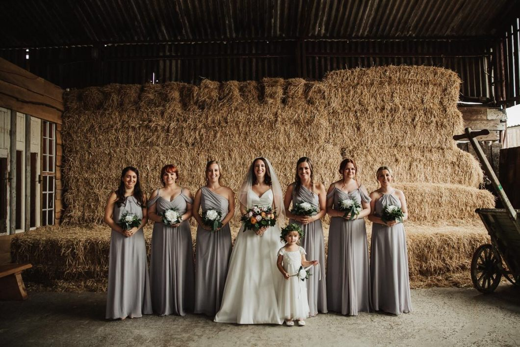 Bridesmaids portraits with hay bales