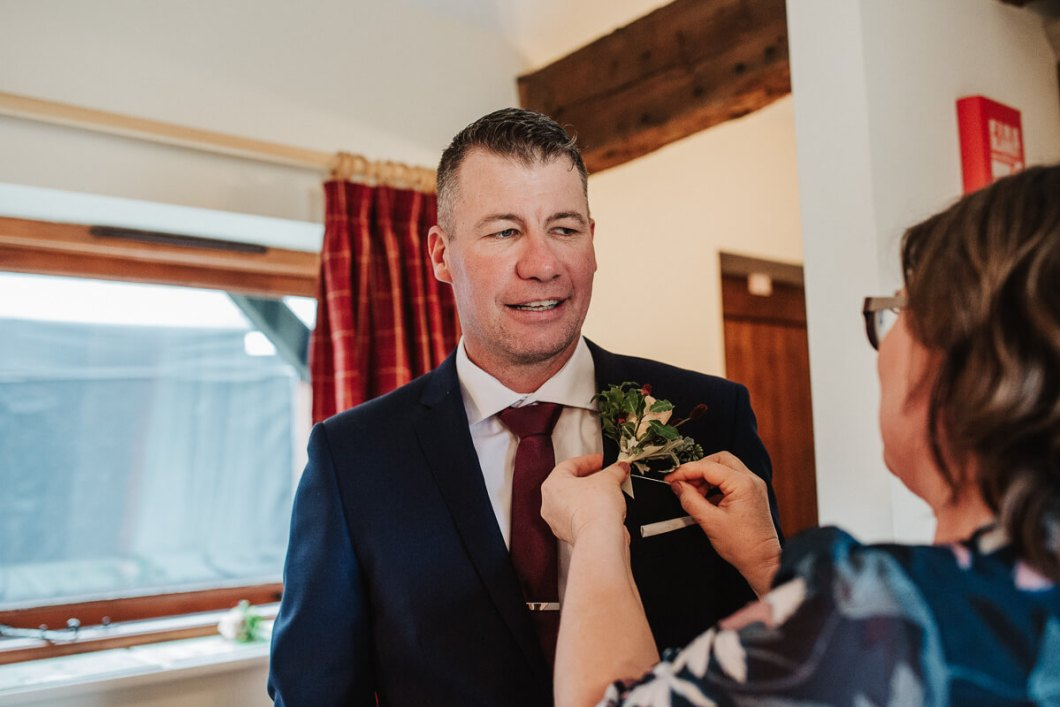 User with with buttonholes from Herbert & Isles