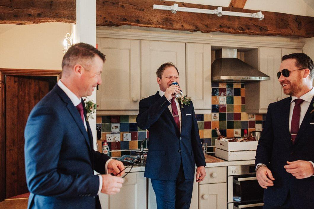 Ushers and groom enjoying beers