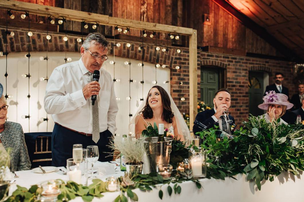 Bride beaming at her father's speech
