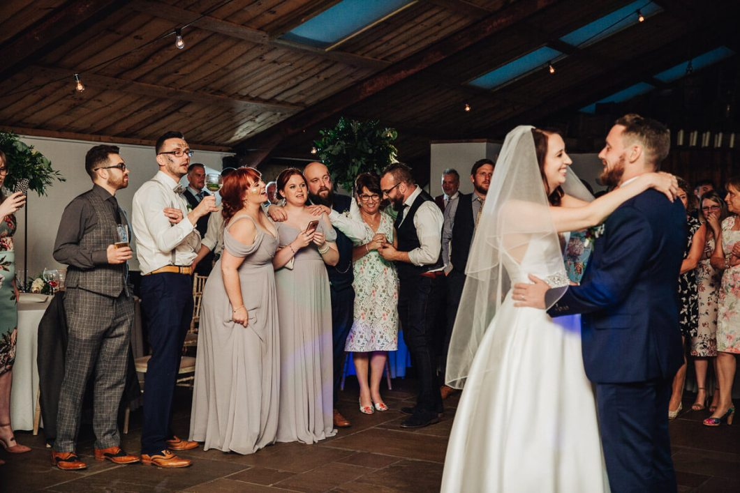 Guests singing along to the first dance