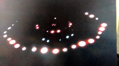 FROM JOHN JEFFAY AT CASCADE NEWS LTD 0161 660 8087 / 07771 957773 john@cascadenews.co.uk.. CASCADE NEWS FOR DUNDEE COURIER.. .. PIC SHOWS - IMAGE CAPTURED BY JOHN MACDONALD.. .. A pensioner has captured an amazing picture of what he believes is a UFO bearing a remarkable resemblance to the alien spacecraft from the film Close Encounters of the Third Kind... John Macdonald¿s spotted the strange lights hovering in the sky near his home in rural Perthshire and says it made a noise like ¿a thousand hoovers.¿.. He managed to take a snap of the aerial object as it hovered for a few minutes before suddenly vanishing in front of his eyes.