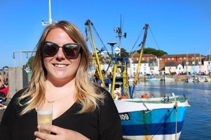 Enjoying a glass of bubbly on Weymouth harbour