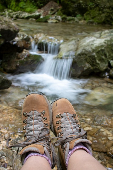 Hiking shoes by waterfall