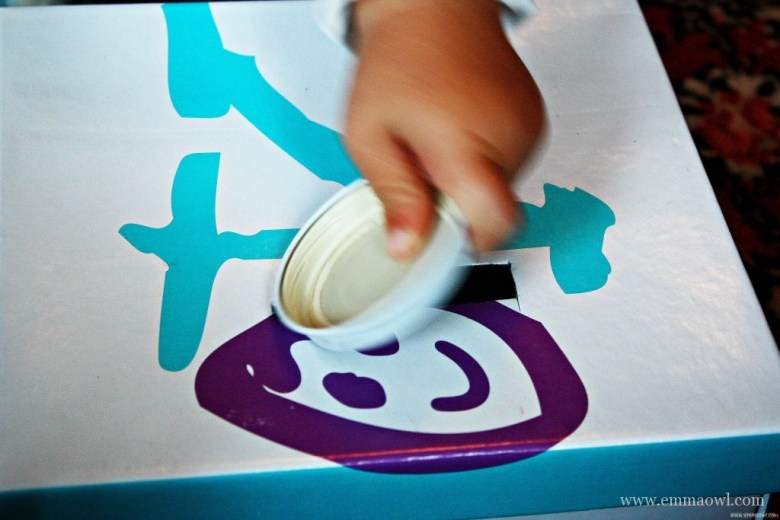 Posting Activity for Children Made from a Shoe Box and Baby Jar Lids