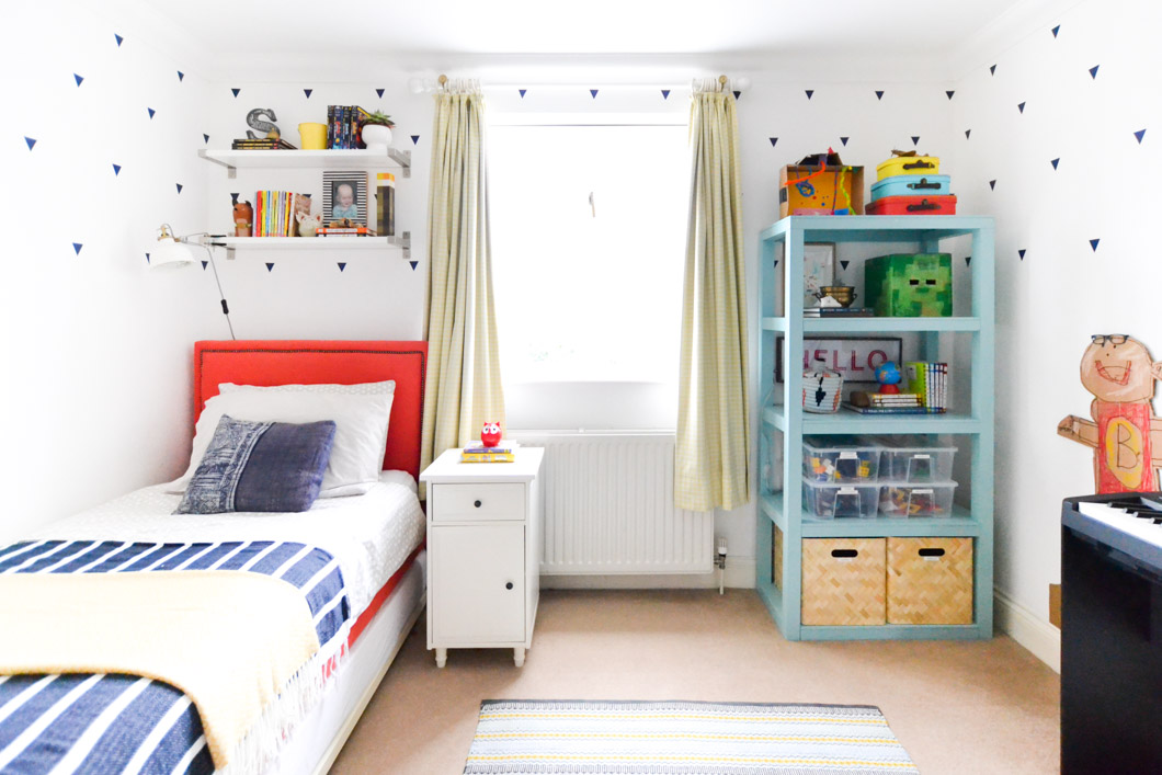 Image of boy's room showing bed and bookcase
