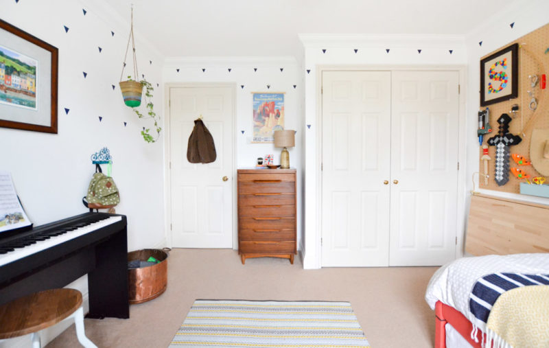Boys room with mid century tall boy and graphic rug