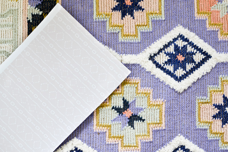 Behe_mudcloth Removable mudcloth wallpaper by Holli Zollinger on Spoonflower + Caravan rug from Anthropologie in Lilac