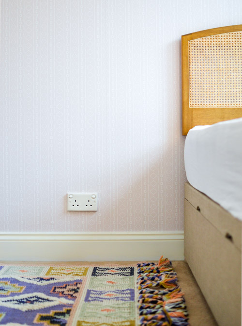 Holli Zollinger Bebe Mudcloth White - Spoonflower Peel & Stick Removable Wallpaper + Anthropologie Rug + Storage Bed