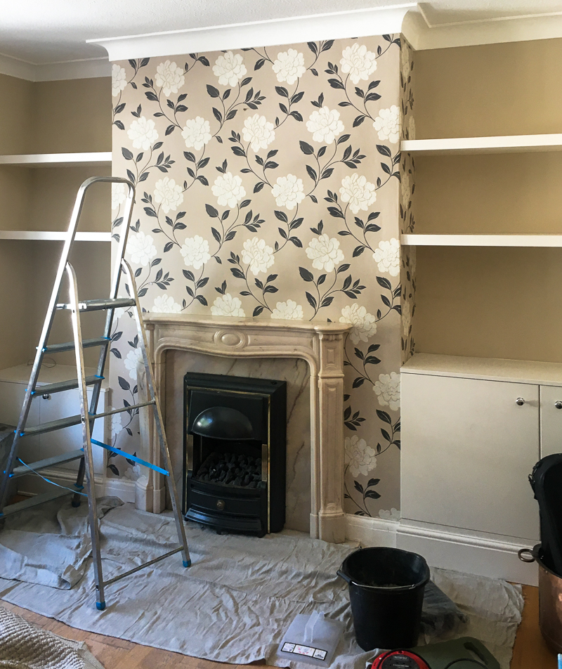 Fireplace wall with floral wallpaper