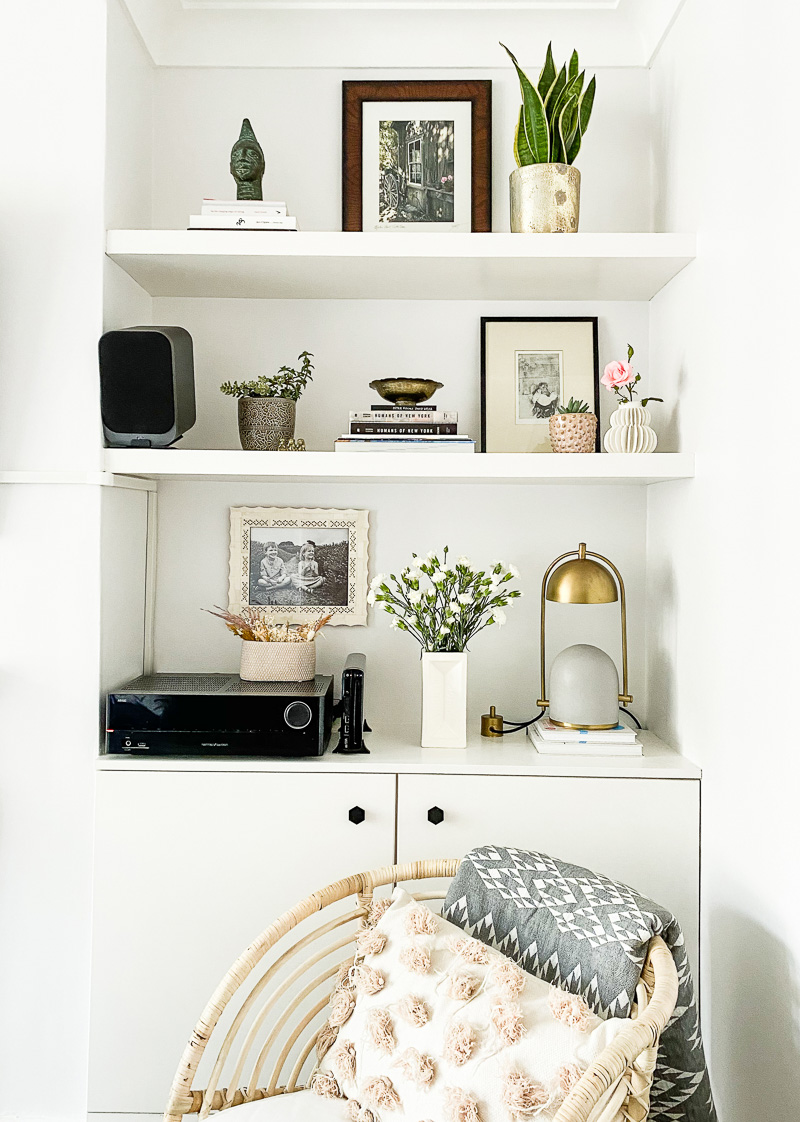 Built in shelf styling with concrete lamp & plants
