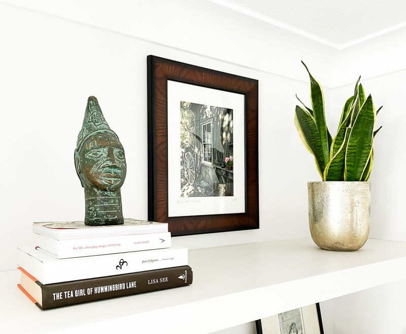 African bronze bust & snake plant shelf styling
