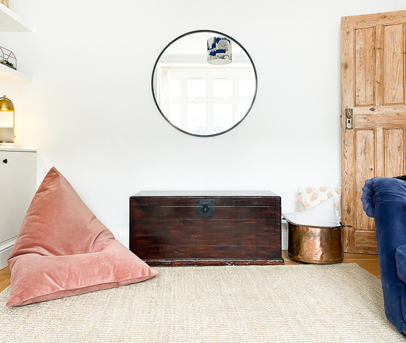 Made.com pink bean bag with sisal rug and modern mirror