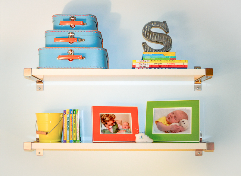 Toy and book storage in toddler boy bedroom