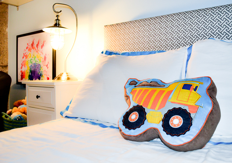 DIY upholstered bed with customised bedding and truck pillow