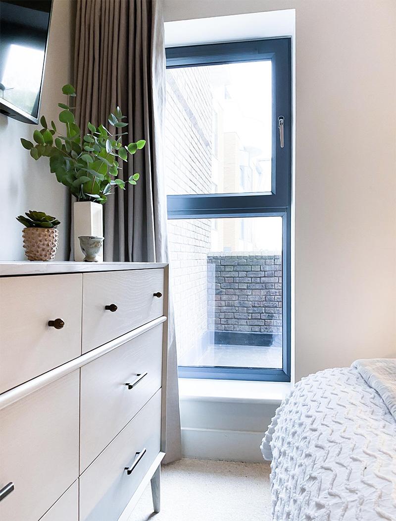 Modern neutral bedroom with West Elm dresser