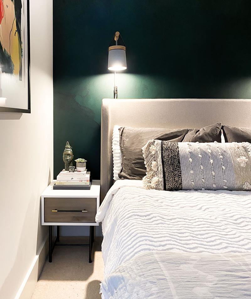 Emerald green wallpaper in modern boho bedroom