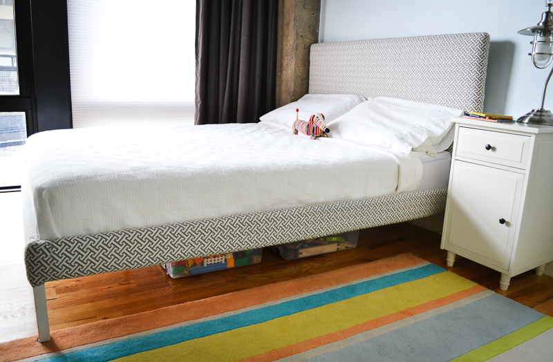 Industrial toddler bedroom with DIY upholstered bed