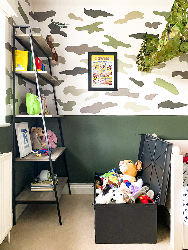 Soft toy storage in military trunk - kids bedroom design
