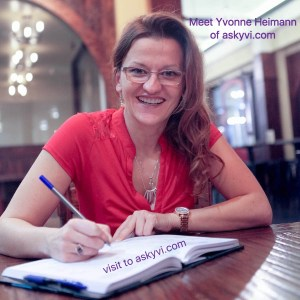 Yvonne Heimann sitting at a desk with notepad