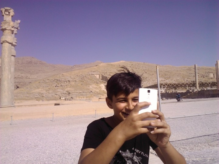 This kid insisted on taking about a gazillion pictures of me, so I started taking a gazillion pictures of him. I was flattered that his older sisters wanted a picture with me when all of Persepolis was behind them though!