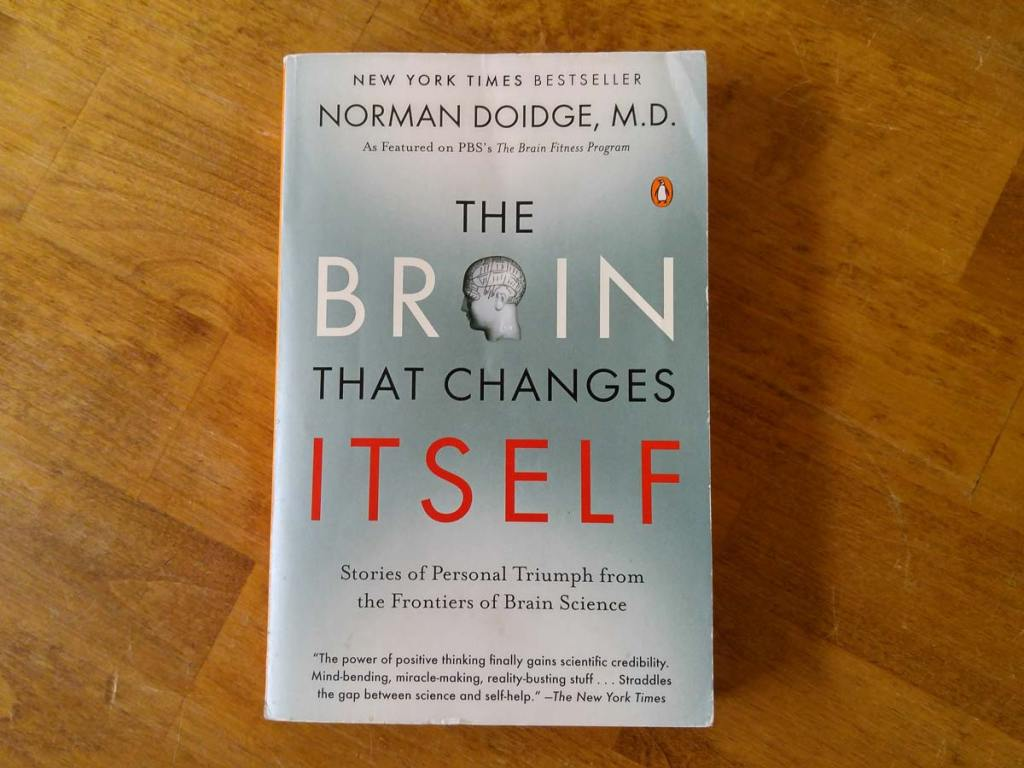 Book cover on a coffee table: The Brain That Changes Itself