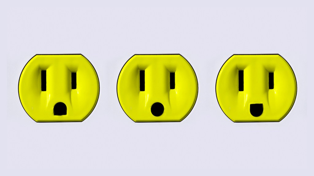 Three bright yellow electrical plugins.