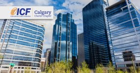 The ICF logo over top of the city of Calgary.