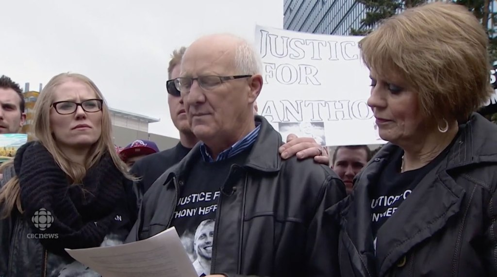 A family at a protest in Calgary.