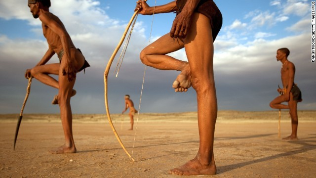 UPINGTON, SOUTH AFRICA - OCTOBER 15: Bushman from the Khomani San community strikes traditional poses in the Southern Kalahari desert on October 15, 2009 in the Kalahari, South Africa. One of the largest studies of African genetics by an international team from the University of Pennsylvania, published in April 2009,  revealed that the San of Southern Africa are the most genetically diverse on earth, and that the San homeland could be the spot where modern humanity began. The Central Kalahari Game reserve is one of South Africa's largest nature reserves, bordering Botswana and Namibia, and is home to the San, or Bushmen, the last indigenous people of South Africa. Many of the San groups were forcibly removed from their ancestral land in the Kalahari Gemsbok National Park in 2002 by neighbouring Botswana's government to make way for Diamond Mining, leaving their traditional nomadic hunter-gatherer lifestyle under threat. In 2006 the Bushmen won an historic ruling against the government allowing them to return to their ancestral land. With no direct access to water and the lure of modern trappings many did not return, choosing to stay in the settlements surrounding the park.  (Photo by Dan Kitwood/Getty Images)