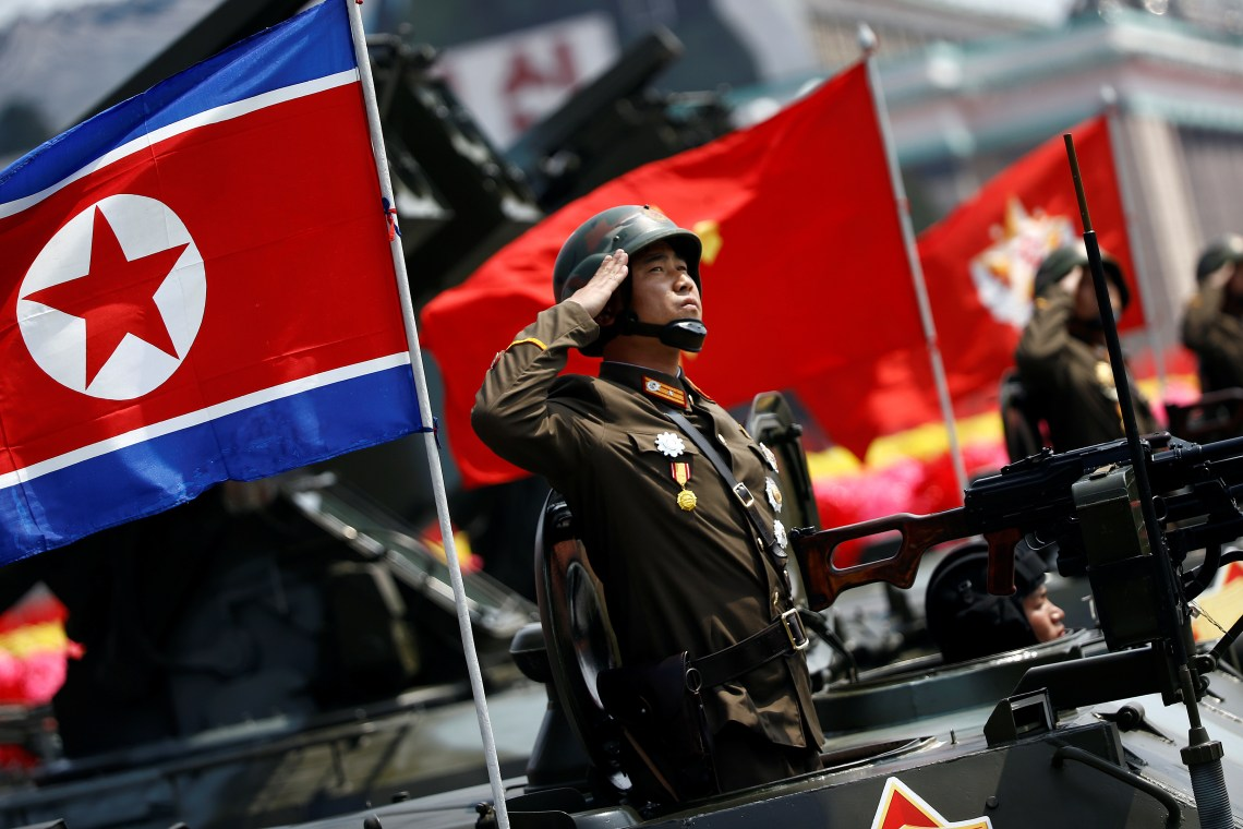 A soldier salutes from atop an armoured vehicle as it drives past the stand with North Korean leader Kim Jong Un during a military parade marking the 105th birth anniversary of country's founding father Kim Il Sung, in Pyongyang April 15, 2017. REUTERS/Damir Sagolj - RTS12E3O