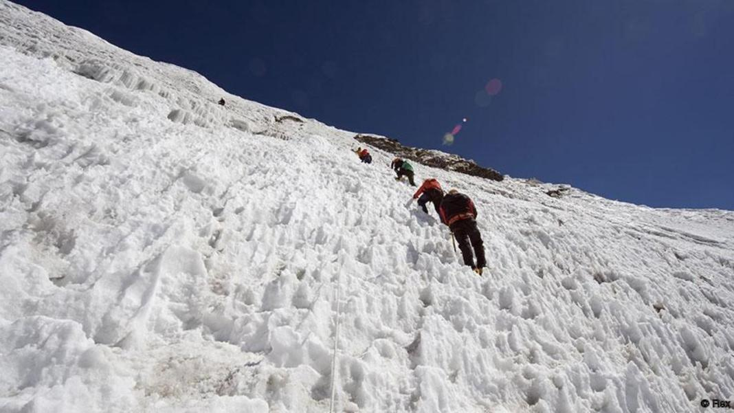 Mandatory Credit: Photo by Christian Kober/Robert Hardi/REX Shutterstock (1267899a) Climbers on an ice wall, Island Peak 6189m, Solu Khumbu Everest Region, Sagarmatha National Park, Himalayas, Nepal, Asia Nepal VARIOUS