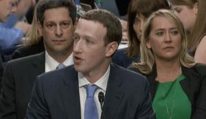 Who Is Sitting Behind Zuckerberg?