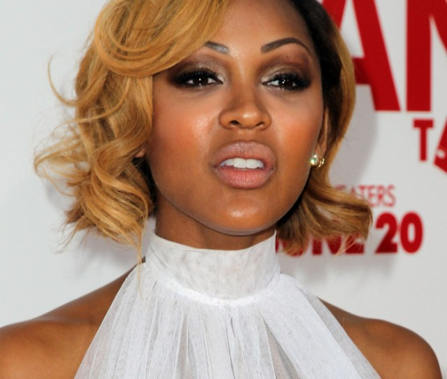 Newly Blonde Actress Meagan Good Goes Glam In Smoky Eye Nude Lip And Flowing White Dress For The Hollywood Premiere Of
