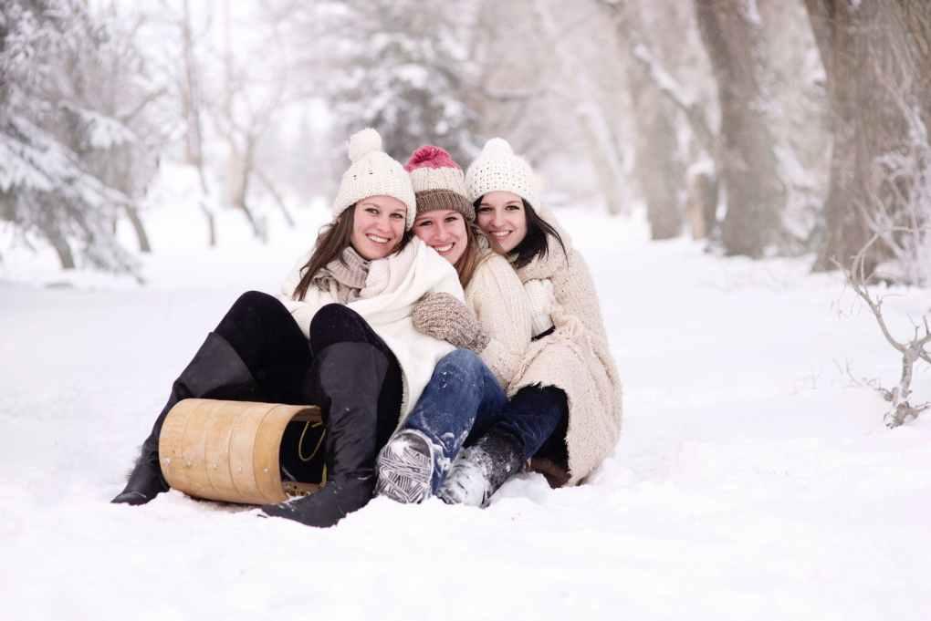 women girls snow toboggan